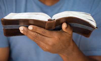 Man Holding and Reading Bible