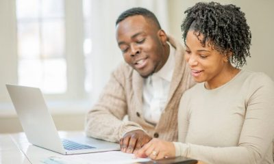 black couple discussing finances