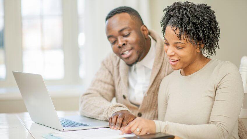 black couple discussing finances