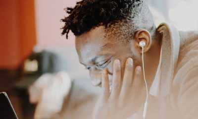 Black man listening to podcast