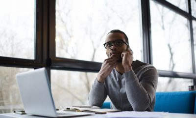 black business man on laptop and phone